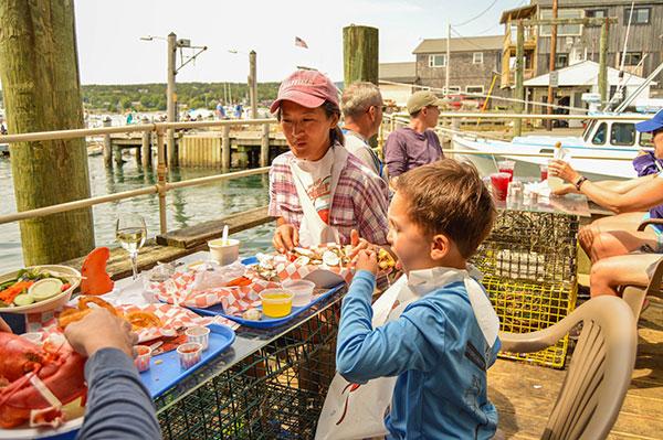 Child eating outside Beal's Lobster